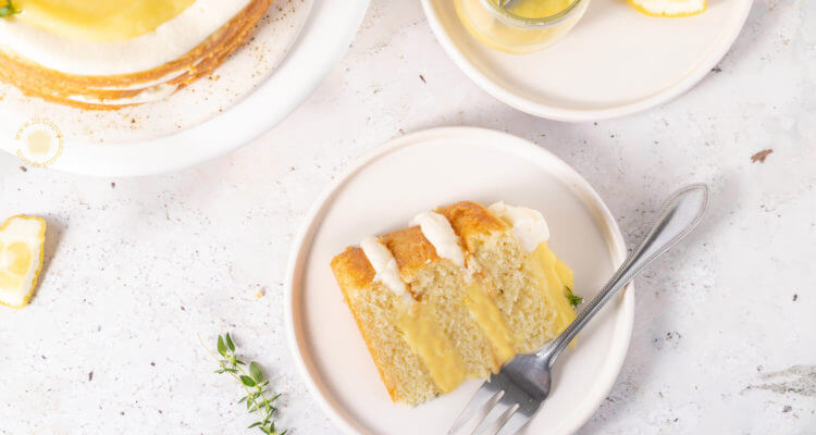 slice of Lemon and thyme layer cake with lemon curd filling | lilcupcakemonkey.com