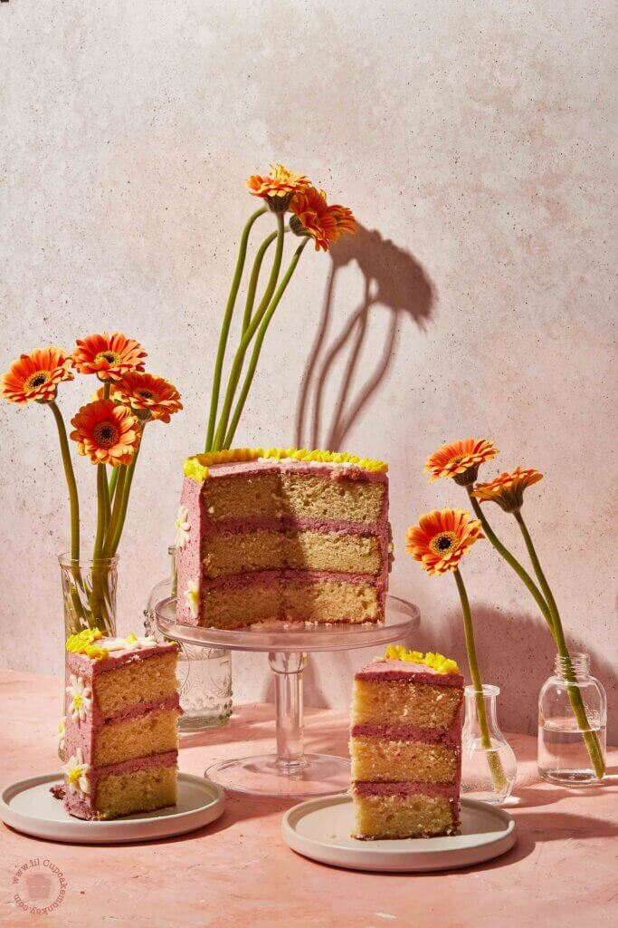 Vanilla and raspberry cake with daisy buttercream